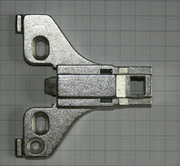 Typical long arm or clip on concealed hinge face frame mounting plate