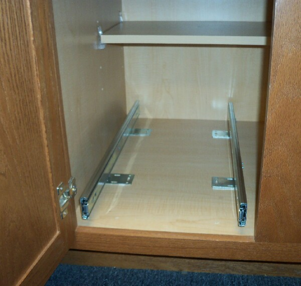"Full extension ""L"" brackets in position for base installation of pullout/rollout shelves"