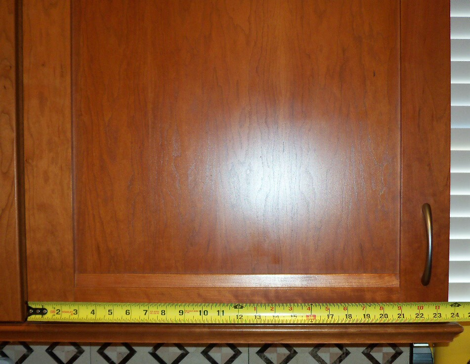 Measure width of the cabinet door