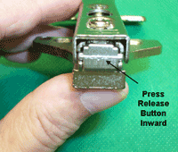 Release button on clip on or long arm style concealed hinge