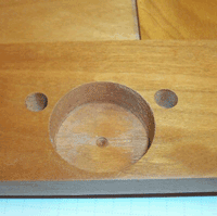 Picture of reverse side of cabinet door, prepared for press-on type hinge, note the additional dowel holes bored next to the mortise cup