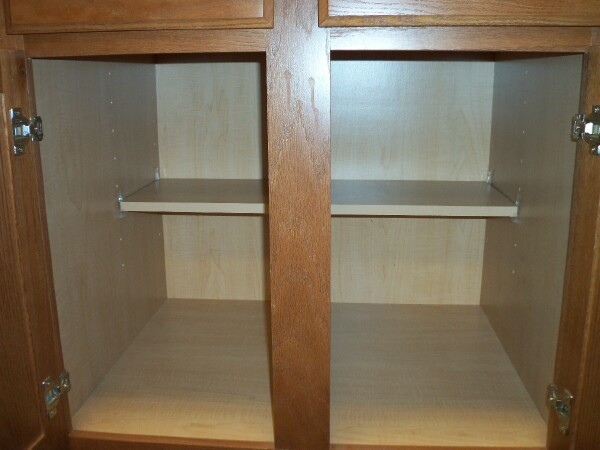 Cabinet opening with a half depth removeable shelf