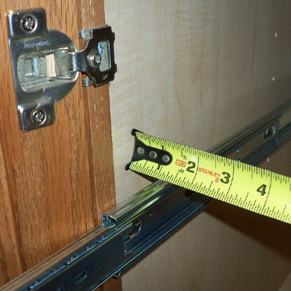 Measure gap between slide and cabinet wall